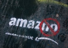 FILE- In this Nov. 16, 2018, file photo graffiti has been painted on a sidewalk by someone opposed to the location of an Amazon headquarters in the Long Island City neighborhood in the Queens borough of New York. Amazon said Thursday, Feb. 14, 2019, that it will not be building a new headquarters in New York, a stunning reversal after a yearlong search. The online retailer has faced opposition from some New York politicians, who were unhappy with the tax incentives Amazon was promised. (AP Photo/Mark Lennihan, File)
