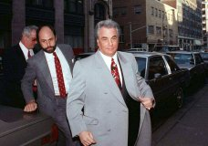 """FILE - In this Feb. 9, 1990 file photo, John Gotti, right, arrives at court in New York. The Gambino family was once among the most powerful criminal organizations in the U.S., but federal prosecutions in the 1980s and 1990s sent Gotti and other top leaders to prison, diminishing its reach. The last Mafia boss to be shot to death in New York City was Gambino don Paul Castellano, assassinated outside a Manhattan steakhouse in 1985 at the direction of Gotti, who then took over the organization. On Wednesday, March 13, 2019, Francesco """"Franky Boy"""" Cali, the reputed boss of New York's Gambino crime family was gunned down outside his home, dying a virtual unknown compared with his swaggering 1980s-era predecessor, the custom-tailored tabloid regular Gotti. (AP Photo/David Cantor, File)"""