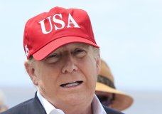 President Donald Trump speaks to reporters during a visit to Lake Okeechobee and Herbert Hoover Dike at Canal Point, Fla., Friday, March 29, 2019. Trump says he will close the nation's southern border, or large sections of it, next week if Mexico does not immediately stop illegal immigration. In a tweet, Trump ramped up his repeated threat to close the border by saying he will do it next week unless Mexico takes action. (AP Photo/Manuel Balce Ceneta)