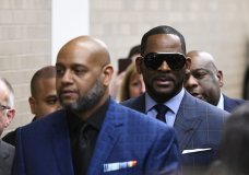 Musician R. Kelly arrives at the Daley Center for a hearing in his child support case at the Daley Center, Wednesday, March 6, 2019, in Chicago. Kelly was charged last month with sexually abusing four females dating back to 1998, including three underage girls. He's pleaded not guilty. (AP Photo/Matt Marton)