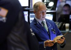 LE- In this March 18, 2019, file photo trader Timothy Nick works on the floor of the New York Stock Exchange. The U.S. stock market opens at 9:30 a.m. EDT on Thursday, March 28. (AP Photo/Richard Drew)
