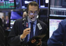 FILE- In this March 13, 2019, file photo Gregory Rowe works on the floor of the New York Stock Exchange. The U.S. stock market opens at 9:30 a.m. EDT on Tuesday, March 19. (AP Photo/Richard Drew, File)