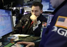 FILE- In this Tuesday, March 5, 2019, file photo specialist Matthew Grenier works on the floor of the New York Stock Exchange. The U.S. stock market opens at 9:30 a.m. EST on Friday, March 8. (AP Photo/Richard Drew, File)