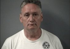 """In this April 24, 2019 is a booking photo provided by the Crystal Lake Police Department of Andrew Freund Sr, who along with his wife Joann Cunningham, have been charged with murder and other charges in the death of their missing son Andrew """"AJ"""" Freund. Authorities say they have found what they believe is the body of the 5-year-old boy who went missing last week. Crystal Lake police Chief James Black said at a news conference Wednesday that police dug up what they believe is Freund's body in a field and that it was wrapped in plastic. (Crystal Lake Police Department via AP)"""