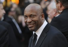 "FILE - In this Feb. 24, 2008 file photo, director John Singleton arrives at the 80th Academy Awards in Los Angeles. The family for Singleton says the filmmaker will be taken off life support Monday, April 29, 2019, after suffering a stroke almost two weeks ago. In a statement Monday, Singleton's family said it was ""an agonizing decision, one that our family made over a number of days with the careful counsel of John's doctors."" (AP Photo/Chris Pizzello, File)"