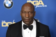 """FILE - In this Feb. 3, 2018 file photo, John Singleton arrives at the 70th annual Directors Guild of America Awards in Beverly Hills, Calif. The """"Boyz N the Hood"""" director suffered a stroke last week and remains hospitalized, according to a statement from his family on Saturday, April 20, 2019. (Photo by Chris Pizzello/Invision/AP)"""