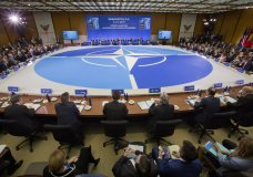 NATO's Secretary General Jen Stoltenberg, center, looks on as Secretary of State Mike Pompeo makes opening remarks at the Meeting of the North Atlantic Council in Foreign Ministers' Session 1 at the US State Department in Washington, Thursday, April 4, 2019. (AP Photo/Pablo Martinez Monsivais)
