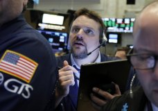 FILE - In this March 12, 2019, file photo, trader Michael Milano works on the floor of the New York Stock Exchange. The U.S. stock market opens at 9:30 a.m. EDT on Tuesday, April 23. (AP Photo/Richard Drew, File)