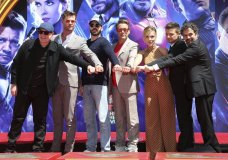 "Marvel Studios President Kevin Feige, from left, poses with members of the cast of ""Avengers: End Game,"" Chris Hemsworth, Chris Evans, Robert Downey Jr., Scarlett Johansson, Jeremy Renner and Mark Ruffalo at a hand and footprint ceremony at the TCL Chinese Theatre on Tuesday, April 23, 2019, in Los Angeles. (Photo by Willy Sanjuan/Invision/AP)"