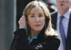 FILE - In this April 3, 2019 file photo, actress Felicity Huffman arrives at federal court in Boston to face charges in a nationwide college admissions bribery scandal. Huffman will plead guilty on May 13 to charges that she took part in the cheating scam. She had been scheduled to enter her plea on May 21, but a judge agreed to move up the hearing because the lead prosecutor will be out of town. (AP Photo/Charles Krupa, File)