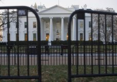 "n this March 24, 2019 photo, The White House is seen behind security barriers in Washington. A White House official turned whistleblower says dozens of people in President Donald Trump's administration were granted access to classified information despite ""disqualifying issues"" in their backgrounds including concerns about foreign influence, drug use and criminal conduct. (AP Photo/Cliff Owen)"