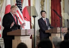 U.S. President Donald Trump, left, speaks as Japanese Prime Minister Shinzo Abe listens during a news conference at Akasaka Palace in Tokyo Monday, May 27, 2019. (Kiyoshi Ota/Pool Photo via AP)