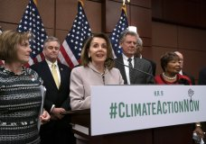 "FILE - In this March 27, 2109, file photo, House Speaker Nancy Pelosi, D-Calif., speaks at an event to introduce the ""Climate Action Now Act,"" at the Capitol in Washington, Wednesday, March 27, 2019, as, from left, Rep. Kathy Castor, D-Fla., who will chair the House Select Committee on the Climate Crisis, Rep. David Trone, D-Md., House Energy and Commerce Chairman Frank Pallone, D-N.J., and Science, Space and Technology Chairwoman Eddie Bernice Johnson, D-Texas, listen. The Democratic-controlled House has approved legislation that would prevent President Donald Trump from following through on his pledge to withdraw the U.S. from a landmark global climate agreement. (AP Photo/J. Scott Applewhite, File)"