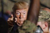 U.S. President Donald Trump gestures to U.S. servicemen at U.S. Navy multipurpose amphibious assault ship USS Wasp at the U.S. Navy's Yokosuka base in Yokosuka, south of Tokyo Tuesday, May 28, 2019. (AP Photo/Eugene Hoshiko)