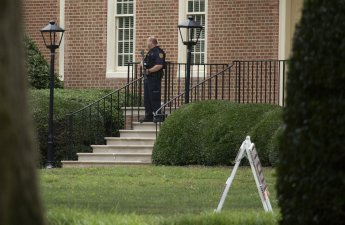 A police officer stands out in front of City Hall next to the building where eleven people were killed during a mass shooting at the Virginia Beach city public works building, Friday, May 31, 2019 in Virginia Beach, Va. A longtime, disgruntled city employee opened fire at a municipal building in Virginia Beach on Friday, killing 11 people before police fatally shot him, authorities said. Six other people were wounded in the shooting, including a police officer whose bulletproof vest saved his life, said Virginia Beach Police Chief James Cervera. (L. Todd Spencer/The Virginian-Pilot via AP