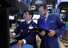 FILE - In this May 28, 2019, file photo specialist Peter Mazza, left, and trader Stephen Gilmartin work on the floor of the New York Stock Exchange. The U.S. stock market opens at 9:30 a.m. EDT on Friday, May 31. (AP Photo/Richard Drew, File)