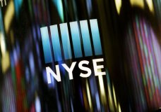 FILE - In this May 13, 2019 file photo, the NYSE logo is displayed at the New York Stock Exchange. A broad slide by technology companies pushed U.S. stocks lower in morning trading on Wall Street Monday, May 20 extending losses into another week. The U.S. decision to ban technology sales to China's Huawei hammered the technology sector, particularly chipmakers. (AP Photo/Mark Lennihan, File)