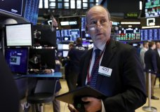 Trader Gordon Charlop works on the floor of the New York Stock Exchange, Tuesday, June 11, 2019. Stocks are rising early Tuesday as Wall Street continues to thrive in June. (AP Photo/Richard Drew)