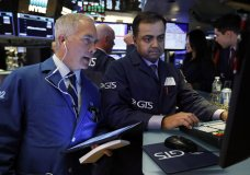 TraderTimothy Nick, left, and specialist Dilip Patel work on the floor of the New York Stock Exchange, Tuesday, June 11, 2019. Stocks are rising early Tuesday as Wall Street continues to thrive in June. (AP Photo/Richard Drew)