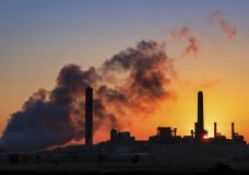 FILE - In this July 27, 2018, file photo, the Dave Johnson coal-fired power plant is silhouetted against the morning sun in Glenrock, Wyo. The Trump administration announced on Wednesday, June 19, 2019, that it has rolled back a landmark Obama-era effort targeting coal-fired power plants and their climate-damaging pollution. (AP Photo/J. David Ake, File)