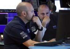 FILE - In this May 29, 2019, file photo specialists James Denaro, left, and Mario Picone work on the floor of the New York Stock Exchange. The U.S. stock market opens at 9:30 a.m. EDT on Wednesday, June 5. (AP Photo/Richard Drew, File)