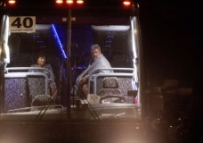 Edward and Jane Jacobucci rest on a bus after leaving Christmas Hill Park following a deadly shooting at the Gilroy Garlic Festival, in Gilroy, Calif., on Sunday, July 28, 2019. The couple, who were manning a booth selling garlic graters, said they took shelter behind their stand as a gunman opened fire in from of them. (AP Photo/Noah Berger)