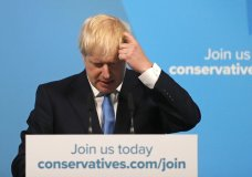 Boris Johnson scratches his head as he speaks after being announced as the new leader of the Conservative Party in London, Tuesday, July 23, 2019. Brexit champion Boris Johnson won the contest to lead Britain's governing Conservative Party on Tuesday, and will become the country's next prime minister. (AP Photo/Frank Augstein)