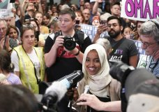 "U.S. Rep. Ilhan Omar speaks to supporters as she arrives at Minneapolis–Saint Paul International Airport, Thursday, July 18, 2019, in Minnesota. President Donald Trump is chiding campaign supporters who'd chanted ""send her back"" about Somali-born Omar, whose loyalty he's challenged. (Glen Stubbe/Star Tribune via AP)"