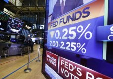 A television monitor on the floor of the New York Stock Exchange headlines the rate decision of the Federal Reserve, Wednesday, July 31, 2019. The Federal Reserve is cutting its key interest rate for the first time in a decade to try to counter threats ranging from uncertainties caused by President Donald Trump's trade wars to chronically low inflation and a dim global outlook. (AP Photo/Richard Drew)