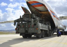 Military vehicles and equipment, parts of the S-400 air defense systems, are unloaded from a Russian transport aircraft, at Murted military airport in Ankara, Turkey, Friday, July 12, 2019. The first shipment of a Russian missile defense system has arrived in Turkey, the Turkish Defense Ministry said Friday, moving the country closer to possible U.S. sanctions and a new standoff with Washington. The U.S. has strongly urged NATO member Turkey to pull back from the deal, warning the country that it will face economic sanctions. (Turkish Defence Ministry via AP, Pool)