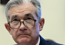 FILE - In this July 10, 2019, file photo Federal Reserve Chairman Jerome Powell testifies before the House Financial Services Committee on Capitol Hill in Washington. Powell has signaled that rising economic pressures, notably from President Donald Trump's trade wars and from a global slowdown, have become cause for concern. (AP Photo/Susan Walsh, File)