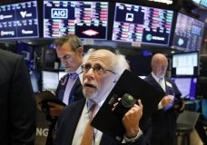 Trader Peter Tuchman works on the floor of the New York Stock Exchange, Monday, July 8, 2019. Stocks fell on Wall Street in morning trading Monday amid growing speculation among investors that unexpectedly strong U.S. employment data may keep the Federal Reserve from aggressively cutting interest rates. (AP Photo/Richard Drew)