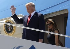 President Donald Trump and first lady Melania Trump arrive at El Paso International Airport to meet with people affected by the El Paso mass shooting, Wednesday, Aug. 7, 2019, in El Paso, Texas. (AP Photo/Evan Vucci)
