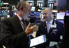 Trader Gordon Charlop, left, and specialist Mario Picone work on the floor of the New York Stock Exchange, Thursday, Aug. 8, 2019. Stock prices rose Thursday as investors braced for the next development in the U.S.-Chinese trade war, which has caused volatility in world markets this week, and after Beijing reported a rise in exports, easing some concerns about its economic slowdown. (AP Photo/Richard Drew)