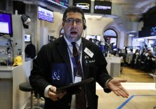 Trader Michael Capolino works on the floor of the New York Stock Exchange, Thursday, Aug. 15, 2019. Stocks are rising on Wall Street early Thursday on indications American consumers continue to spend and embrace online shopping. (AP Photo/Richard Drew)