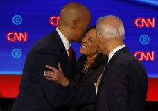 Sen. Cory Booker, D-N.J., former Vice President Joe Biden and Sen. Kamala Harris, D-Calif., talk after the second of two Democratic presidential primary debates hosted by CNN Wednesday, July 31, 2019, in the Fox Theatre in Detroit. (AP Photo/Paul Sancya)