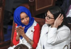 """FILE - In this Feb. 5, 2019 file photo, Rep. Ilhan Omar, D-Minn., left, joined at right by Rep. Rashida Tlaib, D-Mich., listen to President Donald Trump's State of the Union speech, at the Capitol in Washington. Israel's prime minister is holding consultations with senior ministers and aides to reevaluate the decision to allow two Democratic Congresswomen to enter the country next week. A government official said Thursday, Aug. 15, 2019, that Benjamin Netanyahu was holding consultations about the upcoming visit of Omar and Tlaib, and that """"there is a possibility that Israel will not allow the visit in its current proposed format."""" (AP Photo/J. Scott Applewhite, File)"""
