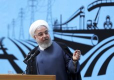In this photo released by the official website of the office of the Iranian Presidency, President Hassan Rouhani speaks in a conference in Tehran, Iran, Monday, Aug. 26, 2019. Rouhani defended his foreign minister's surprise visit to the G-7 summit, saying he ready to go anywhere to negotiate a way out of the crisis following the U.S. pullout from the nuclear deal. (Iranian Presidency Office via AP)