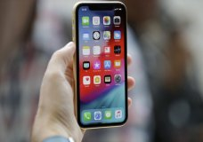 FILE - This Sept. 12, 2018, file photo shows an Apple iPhone XR on display at the Steve Jobs Theater after an event to announce new products, in Cupertino, Calif. Suspected nation-state hackers used malware-laden websites to infect iPhones with spyware in what security researchers are calling the worst general security failure yet affecting the Apple devices. Announced late Thursday, Aug. 29, 2019, by Google researchers, the vulnerabilities were quietly fixed by Apple in February but only after thousands of iPhone users were believed exposed over more than two years. (AP Photo/Marcio Jose Sanchez, File)