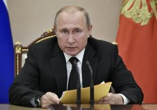 Russian President Vladimir Putin speaks at a meeting with members of the Security Council in the Kremlin in Moscow, Russia, Friday, Aug. 23, 2019. Putin ordered the Russian military to ponder a quid pro quo response after Sunday's test of a new U.S. missile banned under a now-defunct arms treaty. (Alexei Nikolsky, Sputnik, Kremlin Pool Photo via AP)