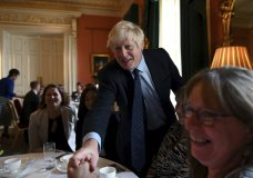 """Britain's Prime Minister Boris Johnson speaks with NHS workers during a reception at 10 Downing Street, London, Tuesday, Sept. 3, 2019. Britain's opposition leader has attacked Prime Minister Boris Johnson for trying to run a """"cabal"""" from Downing Street in order to take Britain out of the European Union without a deal despite the costs. (Daniel Leal-Olivas/Pool Photo via AP)"""