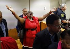 Botham Jean's mother, Allison Jean, rejoices in the courtroom after fired Dallas police Officer Amber Guyger was found guilty of murder, Tuesday, Oct. 1, 2019, in Dallas. Guyger shot and killed Botham Jean, an unarmed 26-year-old neighbor in his own apartment last year. She told police she thought his apartment was her own and that he was an intruder. (Tom Fox/The Dallas Morning News via AP, Pool)