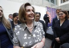 Speaker of the House Nancy Pelosi, D-Calif., left, turns to speak with media members with Rep. Suzan DelBene, D-Wash., right, after they spoke about lowering the cost of prescription drug prices Tuesday, Oct. 8, 2019, at Harborview Medical Center in Seattle. (AP Photo/Elaine Thompson)