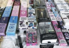 FILE - This Aug. 28, 2019 file photo shows counterfeit packaging for popular vape brands in a display case of a store in downtown Los Angeles. On Thursday, Oct. 3, 2019, the U.S. Centers for Disease Control and Prevention said 1,080 confirmed and probable cases have been reported in 48 states and one U.S. territory. The count includes 18 deaths in 15 states. (AP Photo/Michael R. Blood)