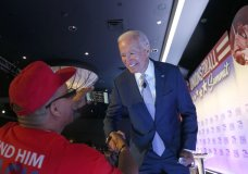 Former Vice President and Democratic presidential candidate Joe Biden, right, greets a supporter at SEIU Unions For All Summit on Friday, Oct. 4, 2019, in Los Angeles. (AP Photo/Ringo H.W. Chiu)