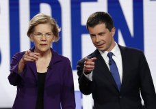 Democratic presidential candidate Sen. Elizabeth Warren, D-Mass., left, and South Bend Mayor Pete Buttigieg stand on stage before a Democratic presidential primary debate hosted by CNN/New York Times at Otterbein University, Tuesday, Oct. 15, 2019, in Westerville, Ohio. (AP Photo/John Minchillo)