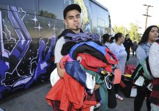 Justin Quintna, of Los Angeles, shops at Chris Brown's yard sale at Brown's home in the Tarzana neighborhood of the San Fernando Valley on Wednesday, Nov. 6, 2019, in Los Angeles. (Photo by Richard Shotwell/Invision/AP)