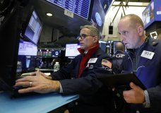 FILE - In this Nov. 20, 2019, file photo specialist Anthony Rinaldi, left, and trader Michael Urkonis work on the floor of the New York Stock Exchange. The U.S. stock market opens at 9:30 a.m. EST on Monday, Nov 25. (AP Photo/Richard Drew, File)