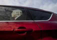 A decal of President Donald Trump sits as though he is riding in the back seat of a supporter's vehicle outside of the meeting before U.S. Rep. Elissa Slotkin speaks during a constituent town hall about her stance on articles of impeachment and address other issues on Monday, Dec. 16, 2019 in the Oakland Center at Oakland University in Rochester, Mich. (Jake May/The Flint Journal via AP)