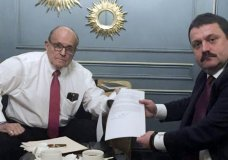 In this handout photo provided by Adriii Derkach's press office, Rudy Giuliani, an attorney for U.S President Donald Trump, left, meets with Ukrainian lawmaker Adriii Derkach in Kyiv, Ukraine, Thursday, Dec. 5, 2019. A Ukrainian lawmaker says he has met up with Rudy Giuliani, President Donald Trump's personal attorney, in Kyiv to discuss an anti-corruption project. Derkach, who has previously accused the son of former Vice President Joe Biden of embezzling money from a gas company in Ukraine, posted photos of Thursday's meeting on his Facebook page. (Adriii Derkach's press office via AP)